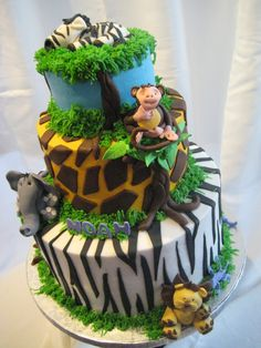 Jungle Animals cake. Cute idea! I would find animal figurines instead of homemade to save time...