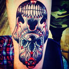 Hamsa tattoo with a sugar skull twist
