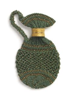 """Pence jug. Knit. c1830-1860. Green silk and copper beads. 4"""" x 2"""""""