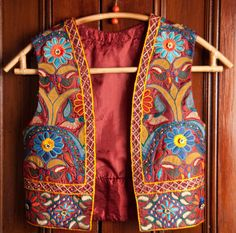 Beautiful vest in the traditional flower motif of Gujarat. Hand embroidered.
