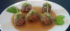 Thai Meatballs - delicate melt in your mouth meatballs in aromatic green curry.  Serve over noodles for an Asian Spaghetti and Meatballs!