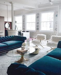 How To Incorporate The Faux Fur Trend Into Any Aesthetic Soho NYC Loft Tamra Sanford Living Room Fuzzy Chairs Blue Velvet Sofas Windows