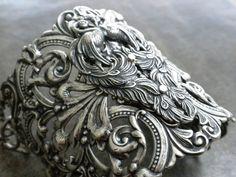 Peacock Jewelry Silver Cuff Bracelet. $58.00, via Etsy.