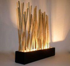 Lampara hecha con madera y bambu