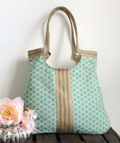 I love all the bags from this etsy shop...and I'm looking to replace my current diaper bag/carry all the things for everyone bag...