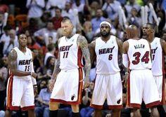 Mar 14, 2014; Miami, FL, USA; Miami Heat guard Mario Chalmers (left to right) Chris Andersen, forward LeBron James, guard Ray Allen, center ...