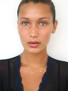 Bella Hadid looks stunning with a bare face and bronze skin