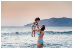 Mom playing in the ocean with her daughter in Tamarindo, Costa Rica. Photographed by Kristen M. Brown, Samba to the Sea Photography.
