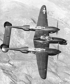"""p38lightning: The P-38 M """"Night Lightning"""". This angle shows not only the radar operator crammed in the back, but also the radar pod up front. The airframe was essentially unchanged in other regards. This version of the P-38 did not see actual combat operations, but was deployed late in the war."""