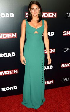 Shailene Woodley is wearing a green Prabal Gurung dress with a key hole detail and a slit with black pearl buttons. The color of this dress is lovely on Shailene! The dress fits her beautifully!