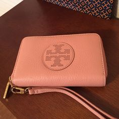 """Tory Burch PINK Leather smartphone wristlet. NWT Style name is Quinn. Color is Baby Pink Leather and its brand new, with tag. Inside has 3 long slit pockets and the other side holds a cell phone (up to iPhone 6). In the middle has a zipper compartment for change. Luggage leather inside and wristlet handle is detachable. Measurements:  4"""" H x 6"""" L   Comes with TB shopping bag and tissue paper. Great to give as a gift.  Tory Burch Bags Clutches & Wristlets"""