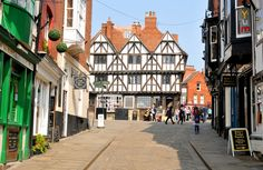 Tourists walk along the cobbled streets of Lincoln, a cathedral city and the county town of Lincolnshire, within the East Midlands of England