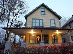 """A Christmas Story"" - This home in Cleveland, Ohio was made famous by the movie, as much for the daring leg lamp (look closely, it's still proudly displayed in the living room window) as for Ralphie's struggles to get a Red Ryder BB Gun for Christmas..."