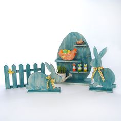 Easter decor set by RussianRockingSheep on Etsy. Handcrafted wooden Easter decor set. This set include wooden egg with shelves, two easter rabbits and small wooden fence.