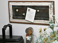 Make unique magnets from vintage earrings then create a magnet board from rusty reclaimed tin and a chippy wood door panel.