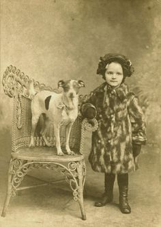 Jack Russell Terrier Dog and Girl in Fur Coat Cabinet Photo.
