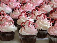 cupcakes with chocolate pink and white hearts on top