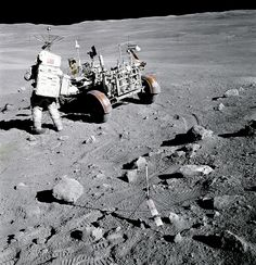 "Apollo 16 astronaut Charles M., pilot of the Lunar Module ""Orion"", stands near the Rover, Lunar Roving Vehicle (LRV) at Station no. near Stone Mountain, during the second Apollo 16 extravehicular activity at the Descartes landing site. Apollo Space Program, Nasa Space Program, Moon Missions, Apollo Missions, Nasa Missions, Cosmos, Moon Landing Conspiracy, Programa Apollo, Nasa History"