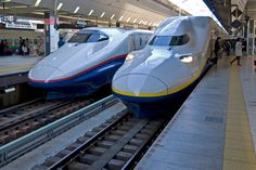 Two bullet trains parked at Shinkansen in Tokyo, Japan.  A minimum of 180 mph? WOW!