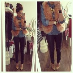 Denim shirt with fur vest.