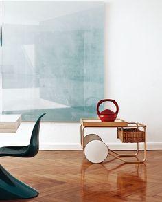 Apartment of Artek CEO Mirkku Kullberg, featured on Italian Elle Decor cover. Alvar Aalto tea cart an Verne Panton chair.