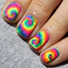 Top 10 Summer Nails For This Season--Make a loud statement this Summer with neon rainbow tie dye nail art. It's colourful, cheerful and they will fit with all your clothes. It'll brighten things right up!