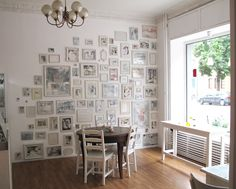 great idea to frame postcards, photos, posters, painting and hang them all on one wall