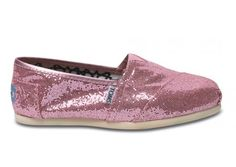 Pink glitter Tom's shoes. By buying these another pair of Tom's shoes will be donated to a kid in need.