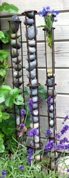 Think I could do this with rebar and I for sure have enough rocks - garden sculpture!