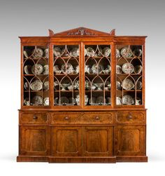 From Windsor House Antiques UK  Attributed to Gillows of Lancaster. An exceptionally fine quality Regency period mahogany Library Breakfront Secretaire Bookcase, the timbers and overall construction of the highest order. The doors and stiles quartered the interior of the secretaire boxwood faced drawers.