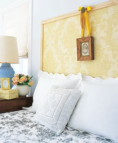 Wallpaper as Headboard - I might copy this idea with some graphic fabric and some painted 2x4's