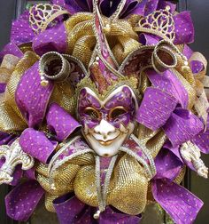 Elegant Mardi Gras Wreath, Mardi Gras Decorations, Party Decor, Jester Mask Wreath, Fleur De Lis  Stunning Mardi Gras party décor fro your door! Ready To Ship!  Luxe Jester Mardi Gras wreath in shimmering gold & purple color scheme. Elegant & regal. The mask is just beautiful. The fleur de lis ornaments are gorgeous & I think you will enjoy the little princess crowns.. Oh & the ribbon...stunning purple with tiny gold sequins in a harlequin design. Looking for a more colorful M...