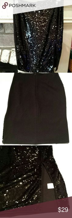 "Skirt by Lovesong Size L Black with sequins and slit up left front side .slit is 10"". Skirt length is 23"". Skirt is NWOT. Lovesong Skirts Pencil"