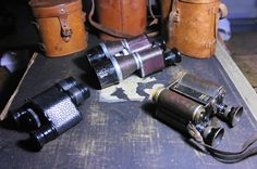"3 innovative english designs. Left: Aitchison, London ""Mono"" 8X Top: Aitchisons Patent  X10 binoculars. Number 892 Around 1905 Aitchison & Co Right: Ross London x8 binoculars with patented cantilever design. Round 1899 first serie. Production. 8X. Number 1678. 19 mm. apature."