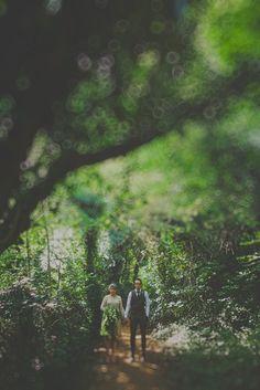 Woods make an affective (and magical) backdrop for couple photos. Photo by Benjamin Stuart Photography #weddingphotography #brideandgroom #woodlandphoto #wedding