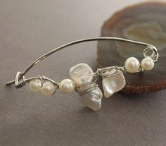 Silver shawl pin, scarf pin in wavy vine design with wrapped white fresh water pearls. $28.00, via Etsy.