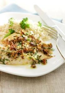 Pecan-Parmesan Fish Fillets — Tender, flaky tilapia with crunchy pecans and savory Parmesan: It's a fish dish that's easy enough for weeknights but special enough for parties.