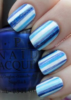 A base coat of Cult Nails Get It On; 2 coats of OPI Alpine Snow; A striper brush and each of these colors: OPI Blue My Mind; Ulta Faded Blues; OPI No Room For The Blues; Nubar Night Sparkle; 1 coat of CDN Silver Sparkling Effect; Top coat of Cult Nails Wicked Fast