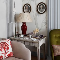 """Grey and white [link url=""""http://www.houseandgarden.co.uk/interiors/wallpaper""""]wallpaper[/link] depicting natural forms and classical columns is offset by round-framed Victorian-style pictures.  Like this? Then you'll love  [link url=""""http://www.houseandgarden.co.uk/interiors/furnishings/rank-and-style/dining-chairs-for-every-budget""""]Dining Chairs for Every Budget[/link]"""