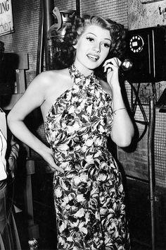 Rita Hayworth in a stunning tiki dress.  I love the neckline.