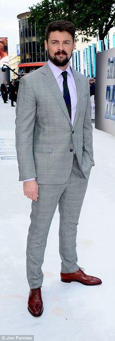 Debonair: Karl Urban rocked a pale grey plaid suit with a lilac shirt and tartan tie...