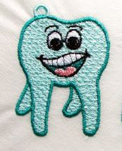 designsbycuties-7379668-71291 http://www.cuteembroidery.com/7379668_fsl-molar-tooth-face.html