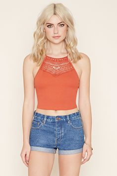 A ribbed knit cami with a cutout crochet panel below its neckline and crisscross cutout accents on each side.
