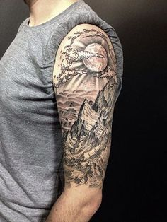 The details on this magnificent tattoo is extremely good. There are the lines that shows its roughness and shadows to denote how steep these are. But the background is a soft fade of faraway lands and the sun shining. #tattoosformenonarm