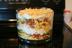Mexican trifle bowl salad from pampered chef. Chicken? Good. Corn bread? Good. Beans? Good. Ranch? Good.