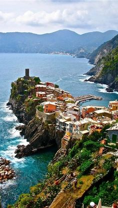 This is an amazing view of Vernazza, Italy. The village of Vernazza is located in Northwestern, Italy and is a tourist destination. It is one of the five towns that make up the Cinque Terre region of Italy. Places Around The World, Oh The Places You'll Go, Places To Travel, Places To Visit, Around The Worlds, Travel Things, Travel Stuff, Dream Vacations, Vacation Spots