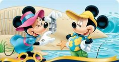 Mickey getting a photo shot from Minnie on the beach