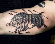 Grey Ink running Boar and Hunting Arrows Tattoo On Bicep