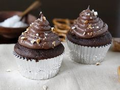 Blogger Paula Jones from Bell'alimento shares a Chocolate Cupcakes with Salted Caramel Center Surprise recipe. A chocolate lover's dream—chocolate cupcakes with a salted caramel center surprise, topped with chocolate frosting and garnished with crushed pretzels.