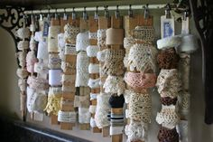 Laces and trim wrapped around hanging rulers. Very cute and clever!